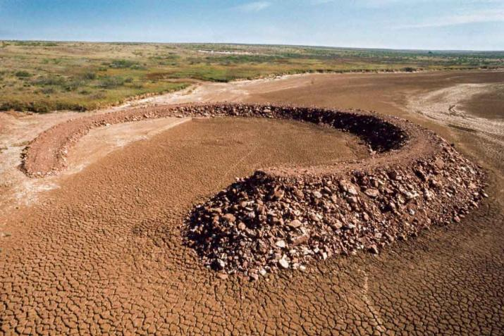 The earth and rock circle of Smithson's Amarillo Ramp spiraling out of the earth.