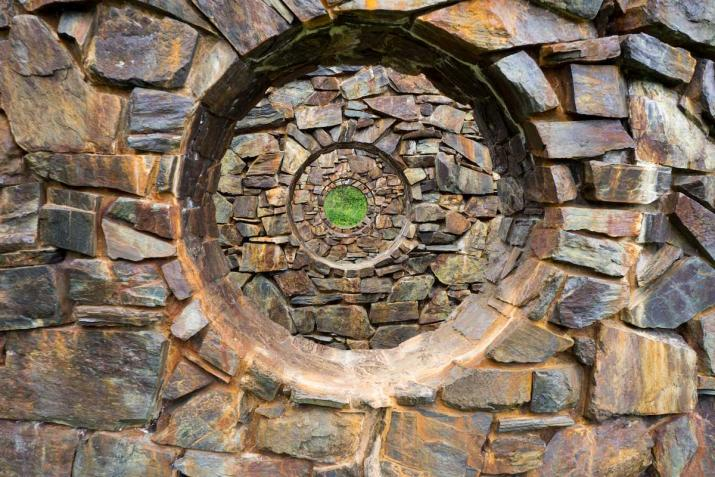 Stone walls receding in space with concentric circular holes in the center