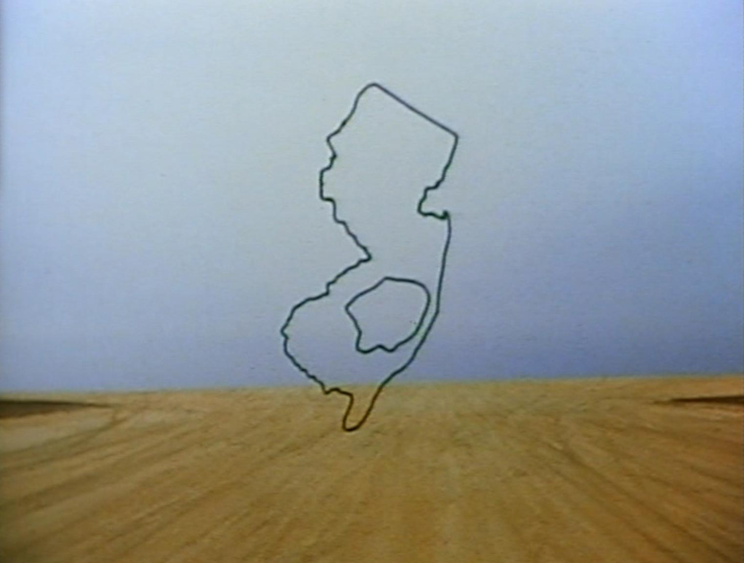 A still from the film Pine Barrens showing an outline of the state of New Jersey superimposed over a stark landscape.