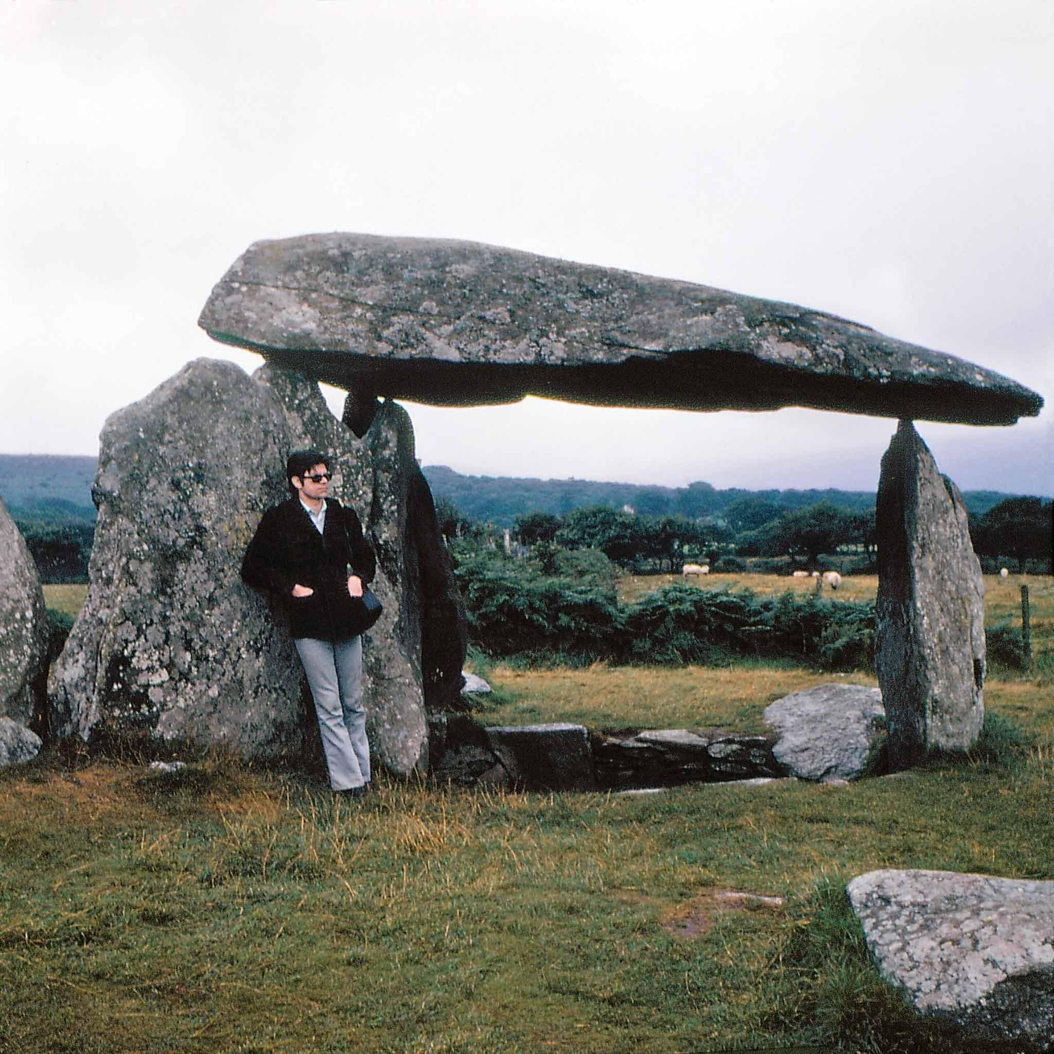 Robert Smithson posing with a dolmen at Pembrokeshire National Park in Wales. Photograph by Nancy Holt.